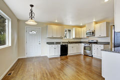 Kitchen with white cabinets and granite tops Stock Photo