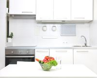 Kitchen in white colors Royalty Free Stock Image
