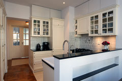 Kitchen in white and ecru Royalty Free Stock Image