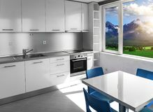 Kitchen with white furniture and windows with mountain scenery. royalty free stock photos