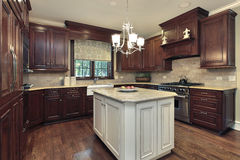 Kitchen with white and granite island Stock Photo