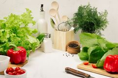 Free Kitchen White Interior With Raw Fresh Green Salad, Red Cherry Tomatoes, Kitchenware On Soft White Wood Table, Copy Space. Royalty Free Stock Image - 106957736