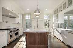 Kitchen with white wood cabinetry Royalty Free Stock Image