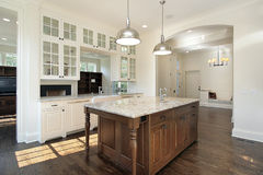 Kitchen with white wood cabinetry Royalty Free Stock Photos