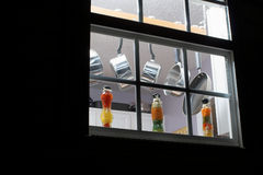 Kitchen Window. Looking at pots and pans through a kitchen window at night stock image