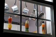 Kitchen Window. Looking at pots and pans through a kitchen window at night royalty free stock photo
