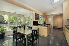 Kitchen with windowed eating area Royalty Free Stock Photo