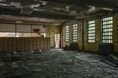 Kitchen with Windows - Abandoned Hospital / Sanitarium - New York. An interior view of a kitchen with windows inside an abandoned hospital in New York stock photo