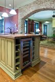 Kitchen with wine refrigerator royalty free stock photography