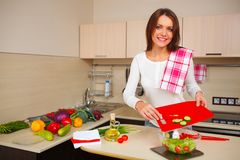 Kitchen woman making salad Royalty Free Stock Photos