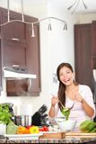 Kitchen woman making salad happy Royalty Free Stock Images