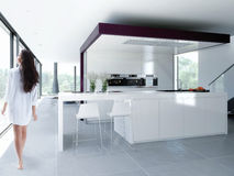 Kitchen. Woman in a white kitchen royalty free stock photo