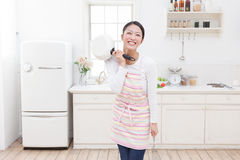 Kitchen and women Stock Photography