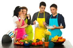 Kitchen women gossip. Wifes gossip and joke about their husbands cooking in kitchen Royalty Free Stock Photos