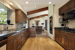 Kitchen with wood cabinetry Royalty Free Stock Photography