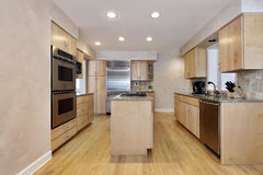 Kitchen with wood cabinetry Stock Images