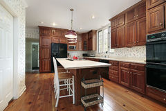 Kitchen with wood cabinets. And white island Royalty Free Stock Images