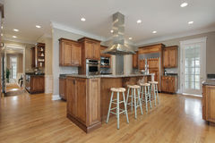 Kitchen with wood and granite center island Royalty Free Stock Photos