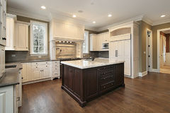 Kitchen with wood and granite island royalty free stock photo