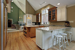 Kitchen with wood and granite island Royalty Free Stock Image