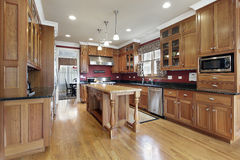 Kitchen with wood island Stock Photos