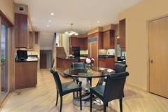Kitchen with wood paneled refrigerator Stock Photos