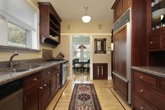 Kitchen with wood paneled refrigerator Royalty Free Stock Photography