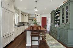 Kitchen with wood top island royalty free stock image