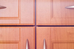 Kitchen wooden cupboard doors. Closeup Royalty Free Stock Photography