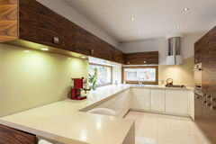 Kitchen with wooden furniture Stock Photography