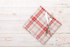 Kitchen. Wooden kitchen table with empty red tablecloth for dinner. Royalty Free Stock Photography