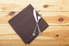 Kitchen. Wooden kitchen table with empty red tablecloth for dinner. Royalty Free Stock Photos