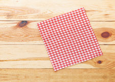 Kitchen. Wooden kitchen table with empty red tablecloth for dinner. Royalty Free Stock Image