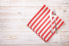Kitchen. Wooden kitchen table with empty red tablecloth for dinner. stock image