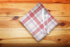 Kitchen. Wooden kitchen table with empty red tablecloth for dinner. Stock Images