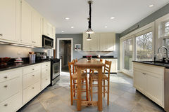 Kitchen with wooden table Stock Images