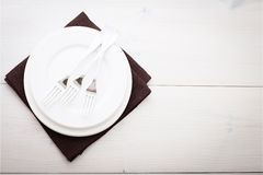 Kitchen. Wooden table with empty plate, tablecloth for dinner. Kitchen. Wooden kitchen table with empty plate, tablecloth for dinner. View from above with copy Stock Photography