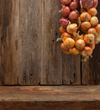 Kitchen wooden table wall background onions brunch Royalty Free Stock Photos