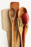 Kitchen wooden utensils on a white background Stock Photography