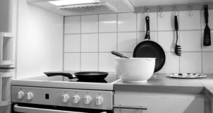 Kitchen work zone filled with objects in black and white stock photography