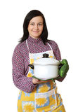 Kitchen worker. The woman of average years with a saucepan in hands on a white background Royalty Free Stock Photography
