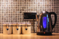 Kitchen worktop and kettle. With a tile background royalty free stock photography