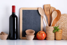 Kitchenware with blackboard. On white wall stock photos