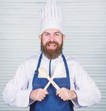 Kitchenware and cooking concept. Lets try taste. Add some spices. Man with beard in cook hat and apron hold cooking. Tools. Cooking as professional occupation royalty free stock photos