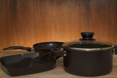 Kitchenware, cookware set on wood table ,wooden and light backgr. Ound stock photos