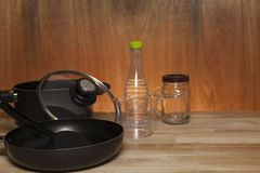 Kitchenware, cookware set on wood table ,wooden and light backgr. Ound stock images