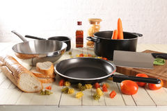 Kitchenware over wood. Kitchenware over the wood table stock images