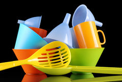 Kitchenware of plastic. On the black background royalty free stock image
