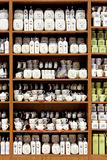 Kitchenware porcelain. Big cupboard with bunch of porcelain kitchenware Royalty Free Stock Photos