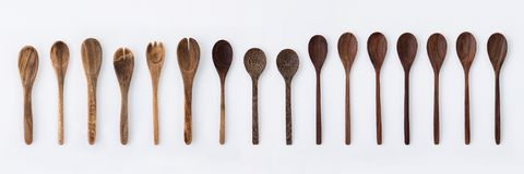 Kitchenware set of wooden fork, spoon and utensils on white back Stock Photography